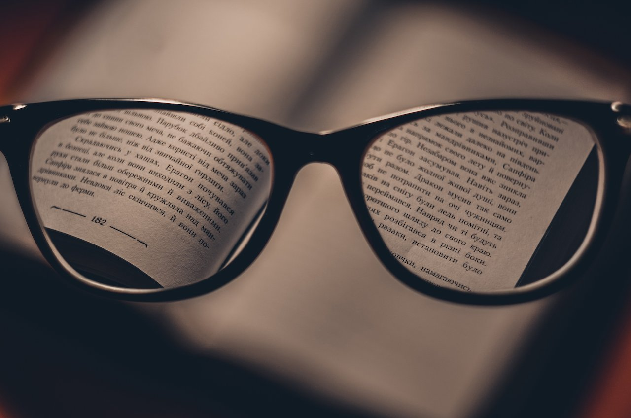 Glasses showing book text
