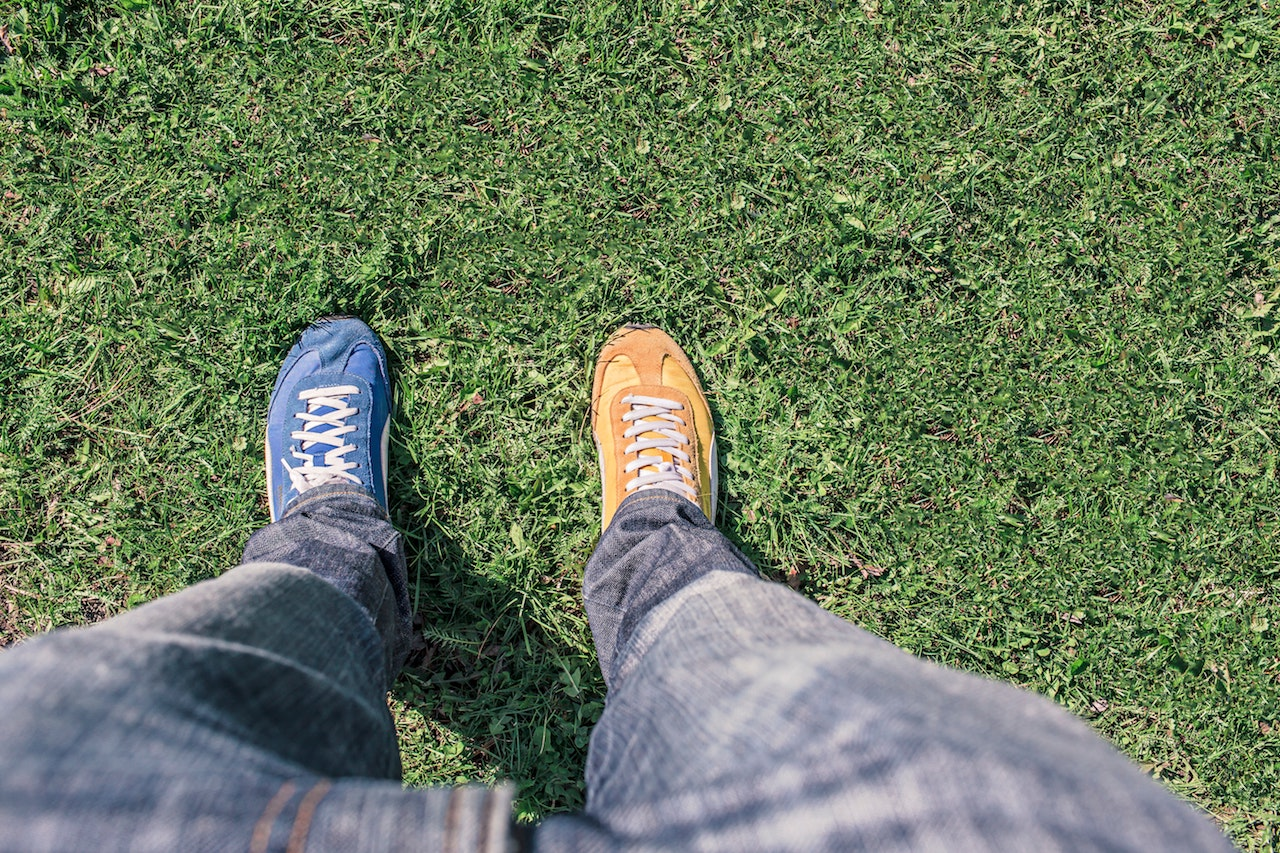 Odd shoes on grass