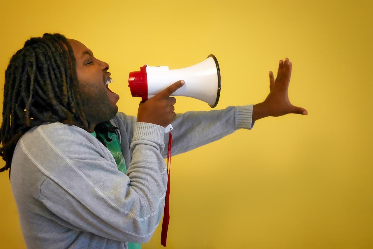 Man singing into a megaphone